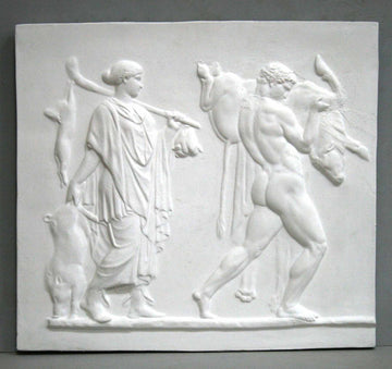 photo of plaster cast sculpture relief with two figures walking towards the right, the male, Hercules, carrying a boar, and the female carrying