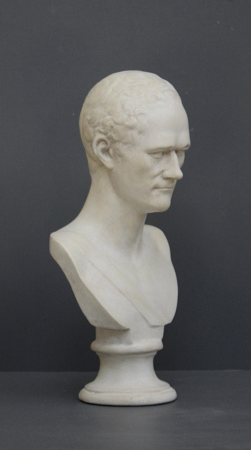 photo with gray background of plaster cast bust of Alexander Hamilton
