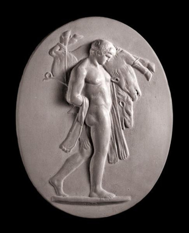 Image of a small plaster plaque of Hercules carrying a boar on a black background