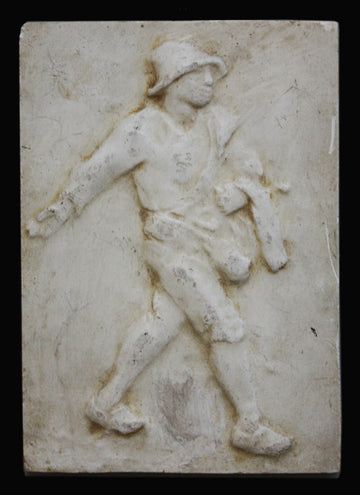 photo of plaster cast relief of man walking with a black background