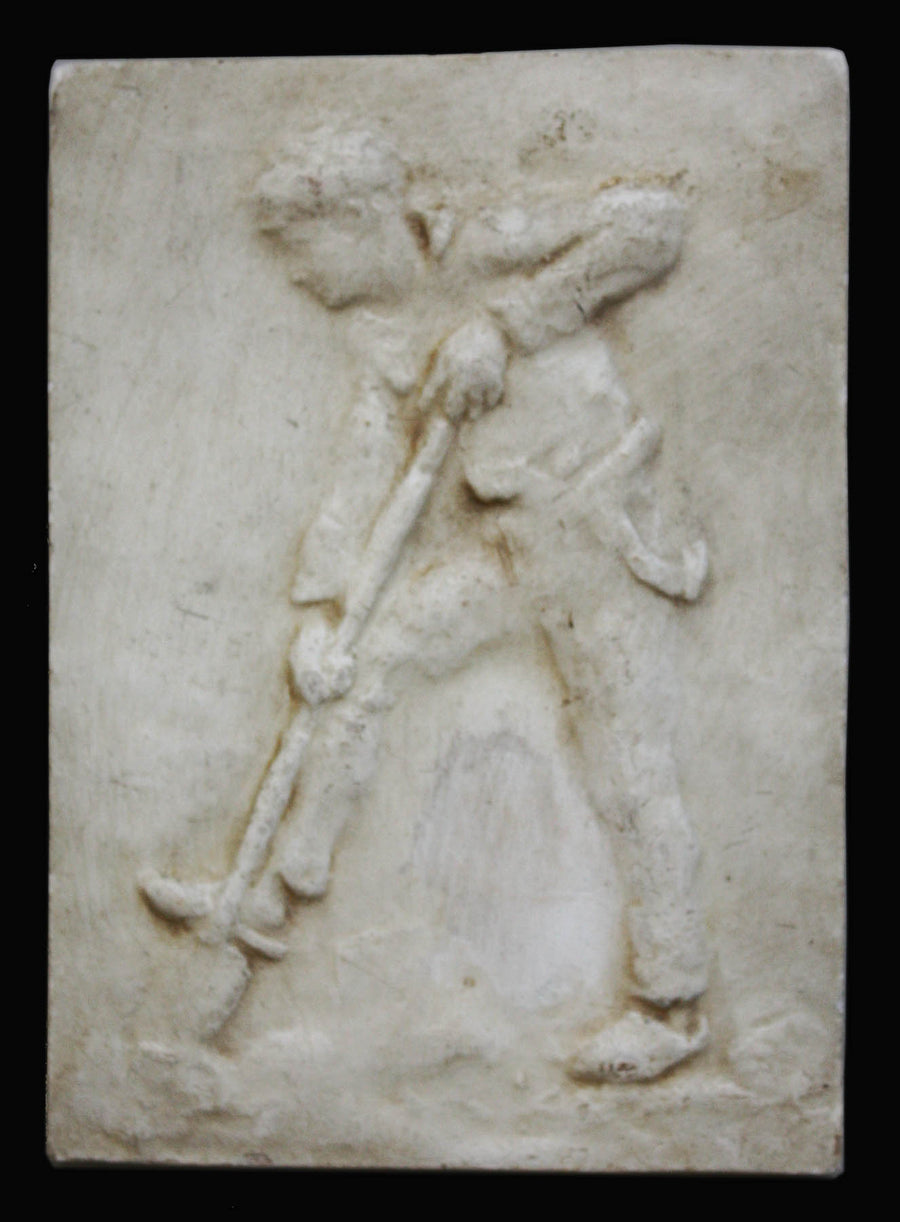 photo of plaster cast relief of man digging with a black background