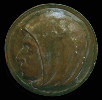 photo of painted green plaster cast of relief with man's portrait in profile with a black background