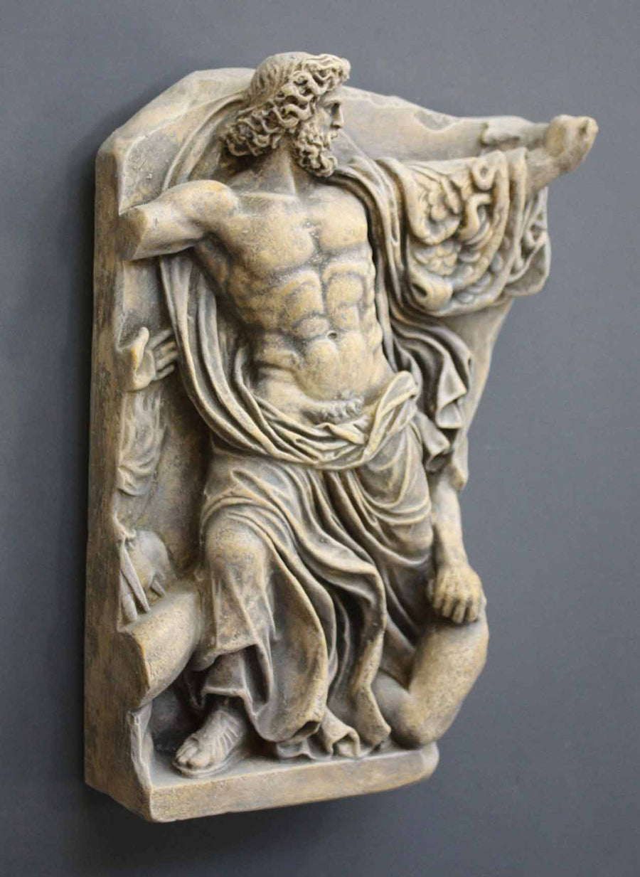 photo of plaster cast relief fragment of man, namely the god Zeus, on a gray background