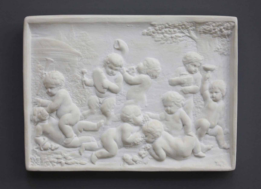 photo of plaster cast relief of one satyr and eight children wrestling and playing instruments with trees and domed building in the background on a gray background