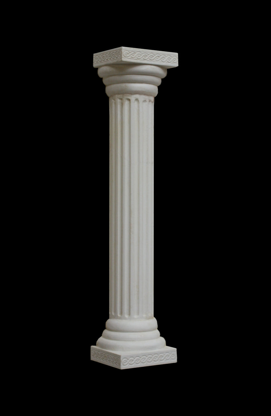photo with black background of plaster cast sculpture of Greek half round column
