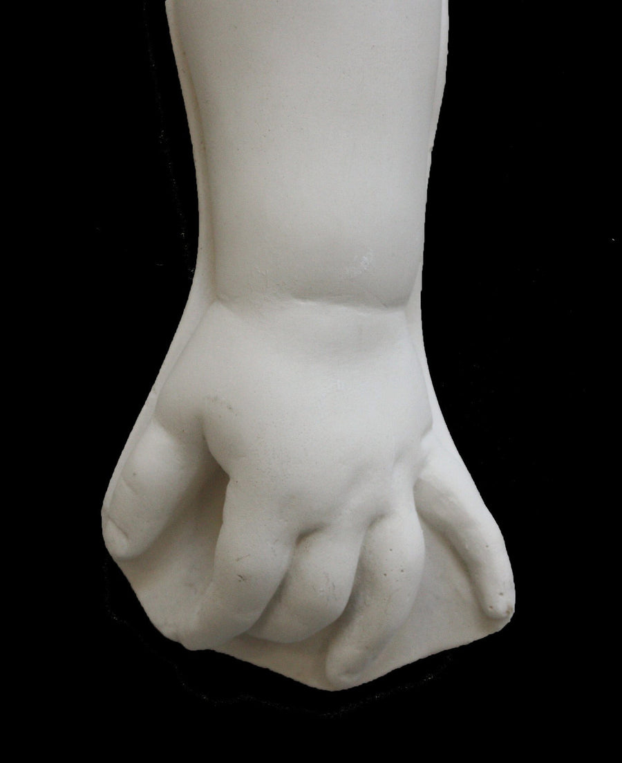 photo with black background of plaster cast of baby arm past the elbow
