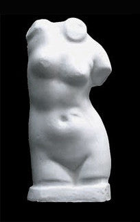 Photo with black background of plaster cast sculpture of female torso
