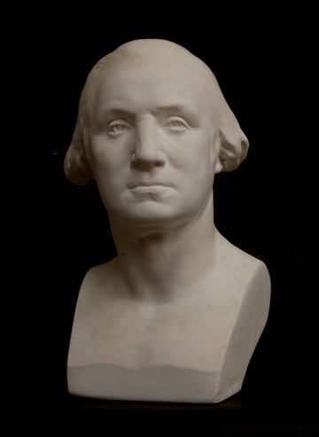 Photo of plaster cast of male bust on black background