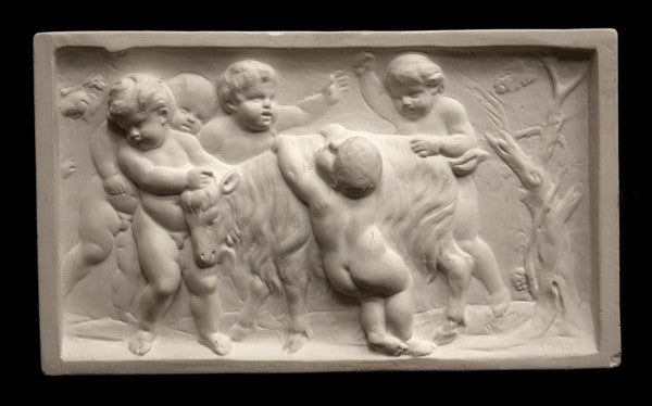 photo of plaster cast relief sculpture of several putti around a goat celebrating the god Bacchus