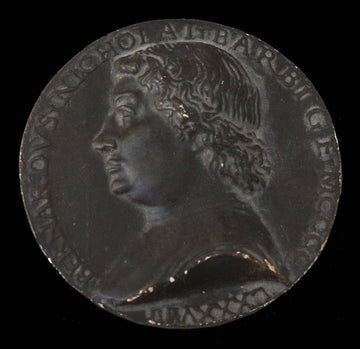 photo of plaster cast of small medallion with male portrait profile on black background