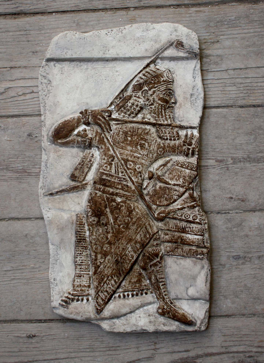 Photo of plaster cast sculpture of ancient sculpture relief on a wooden wall