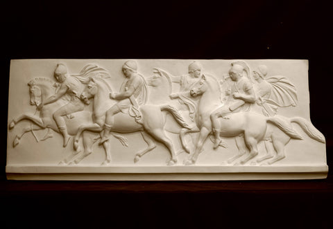 photo of plaster cast relief of men on horses on black background