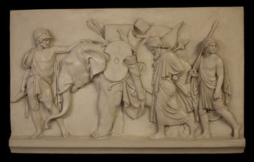 Photo of plaster cast of The Triumphal Entry of Alexander into Babylon, figures with elephant, on a black background
