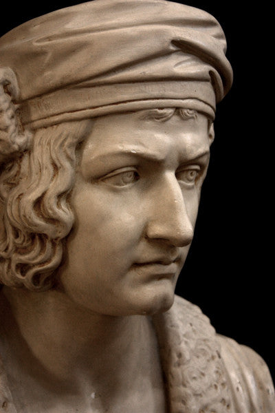photo of plaster cast sculpture bust of man, namely Christopher Columbus, in robes and hat with black background