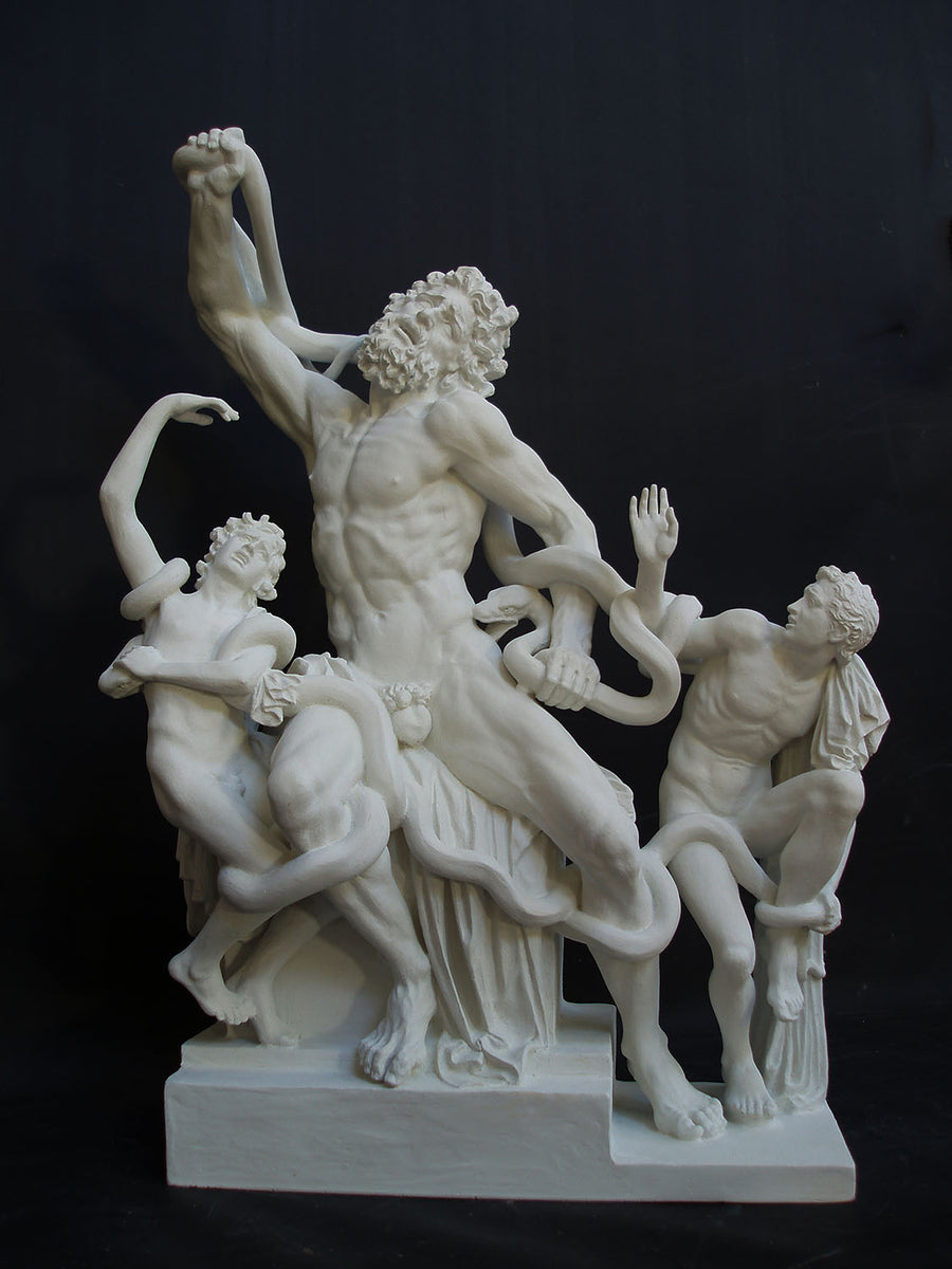 photo with black background of plaster cast sculpture of partially nude male figure, namely Laocoon, and two nude young men being attacked by serpents which twist in and out of the three figures