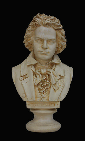 photo of plaster cast sculpture bust of man, namely Beethoven, with suit and ruffled necktie