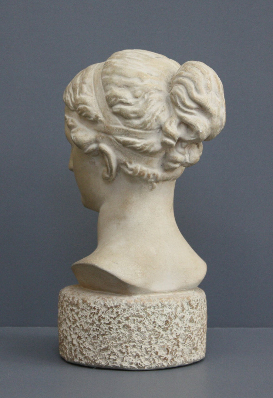Photo of Plaster Cast sculpture bust of goddess Hebe on a gray background