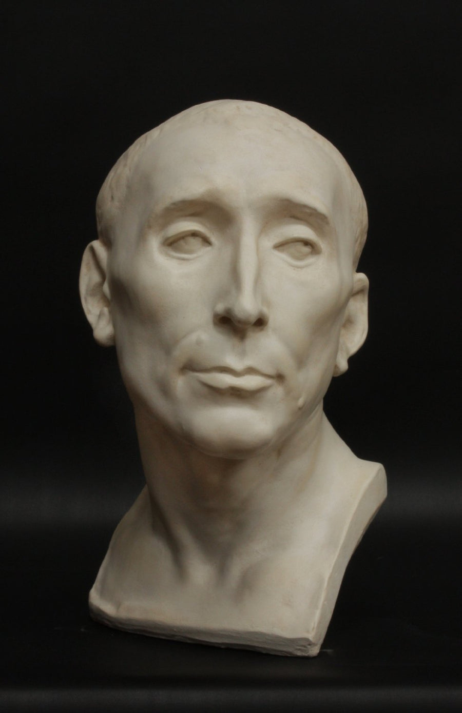 photo with black background of plaster cast sculpture bust of man, namely Niccolo da Uzzano
