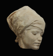 Photo of plaster cast of Nubian Female Mask on a black background