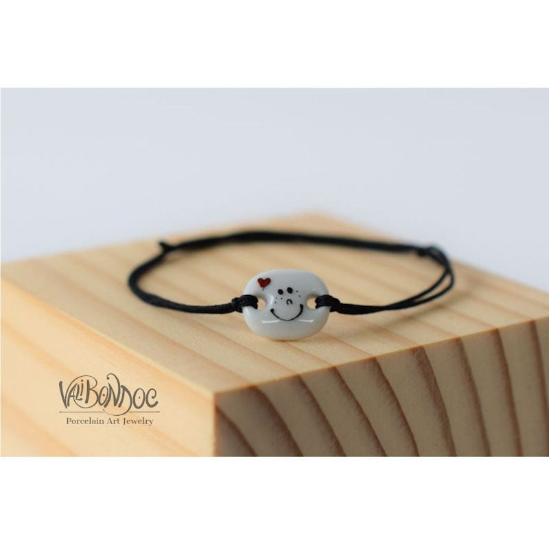 Smiley face with heart .Porcelain bracelet handmade and hand painted by Vali Bondoc