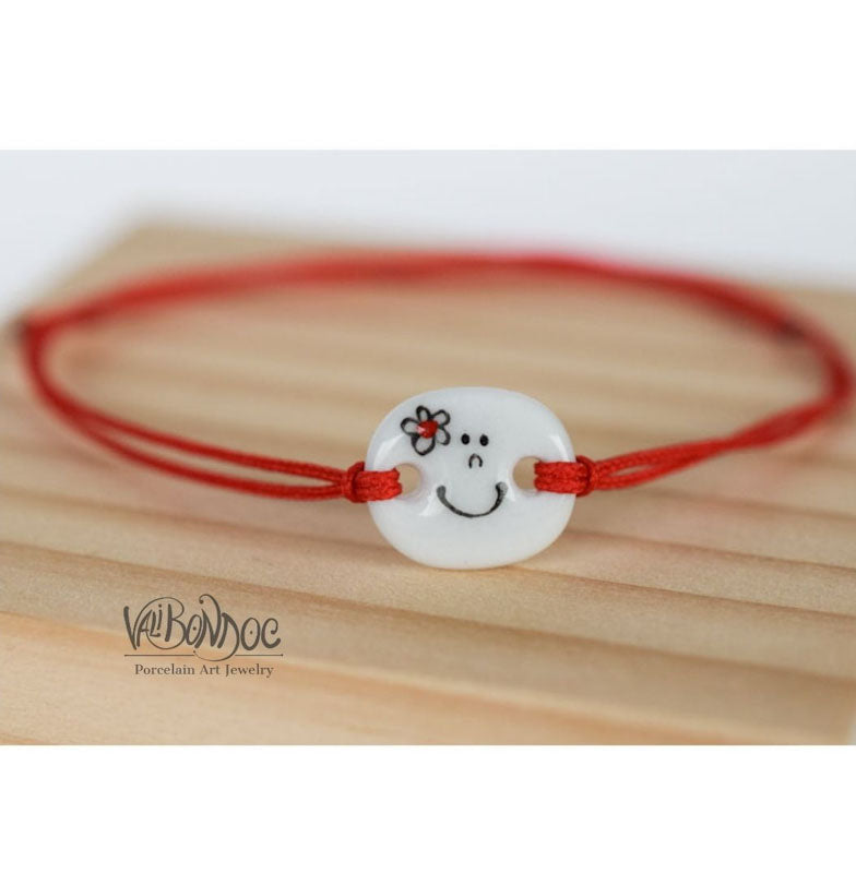 Smiley face with flower .Porcelain bracelet handmade and hand painted by Vali Bondoc
