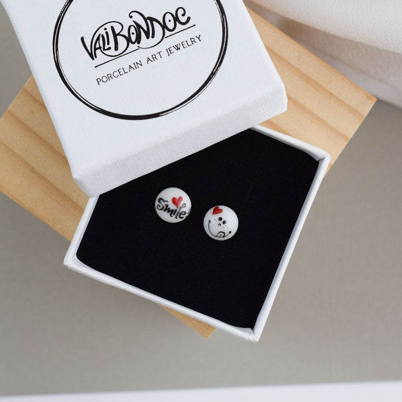 Porcelain stud earrings created and hand-painted by Vali Bondoc with high temperature ceramic dyes