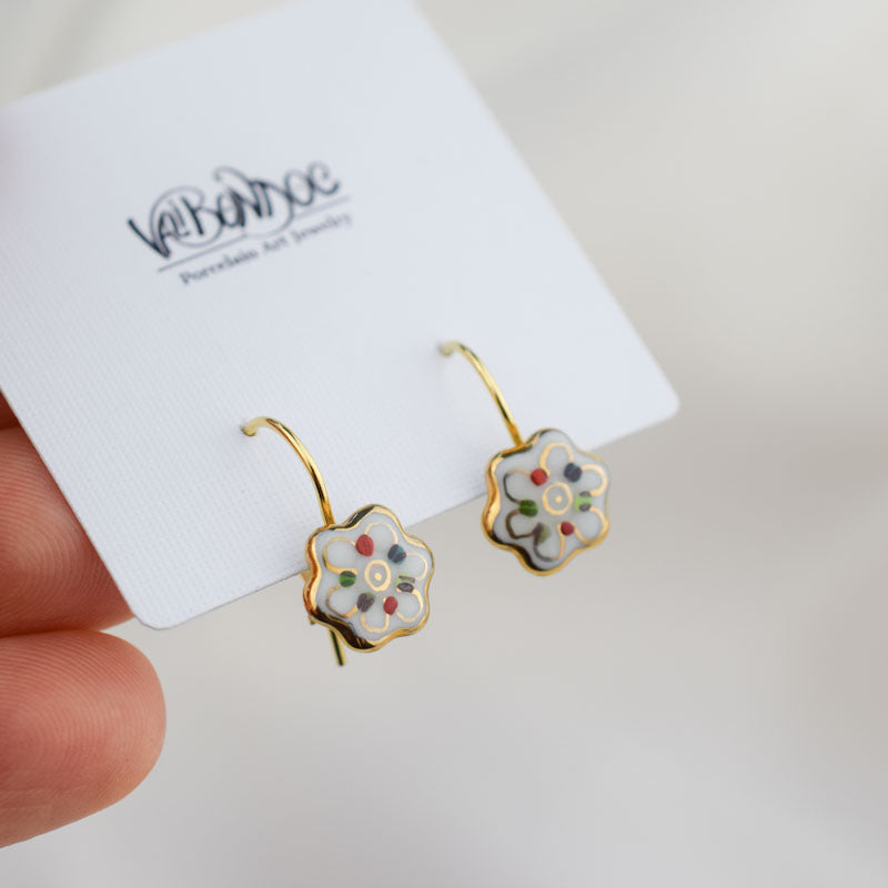 Porcelain hook earrings created and hand-painted by Vali Bondoc with high temperature ceramic dyes and colloidal gold