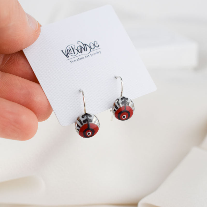 Porcelain hook earrings created and hand-painted by Vali Bondoc with high temperature ceramic dyes and colloidal platinum