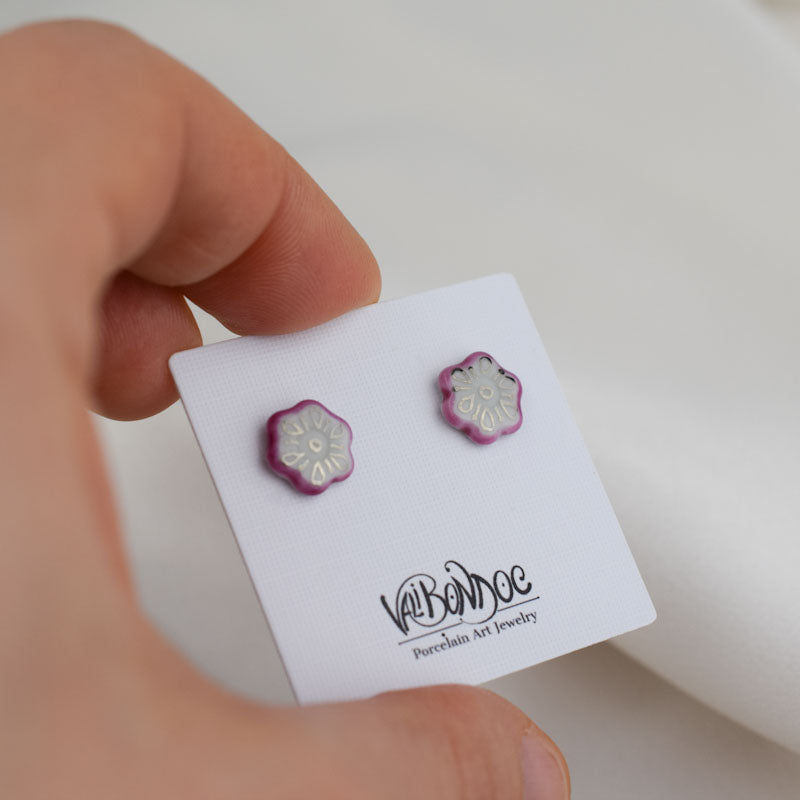 Porcelain stud earrings created and hand-painted by Vali Bondoc with high temperature ceramic dyes and colloidal gold