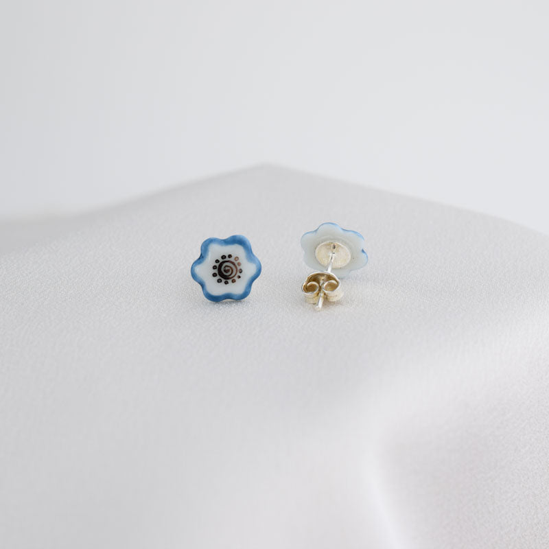 Porcelain stud earrings created and hand-painted by Vali Bondoc with high temperature ceramic dyes and platinum
