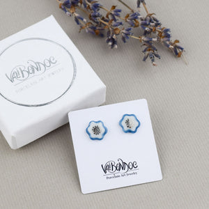 Porcelain stud earrings created and hand-painted by Vali Bondoc with high temperature ceramic dyes and colloidal platinum
