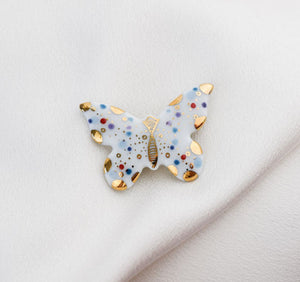 Butterfly. Porcelain brooch created and hand-painted by Vali Bondoc with high temperature ceramic dyes and colloidal gold