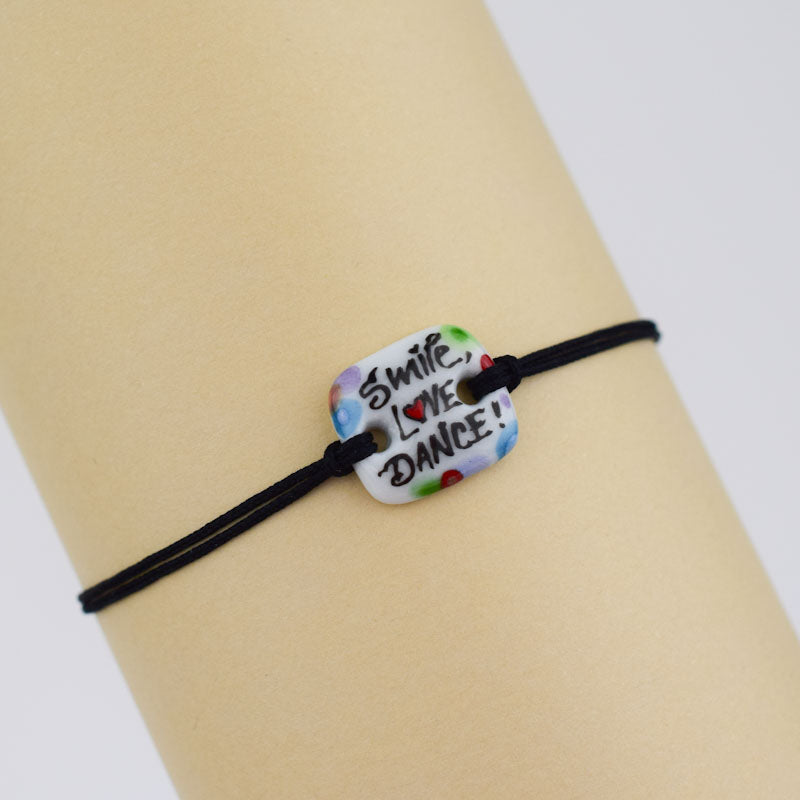 Load image into Gallery viewer, Smile-love-dance. Porcelain bracelet handmade and hand painted by Vali Bondoc
