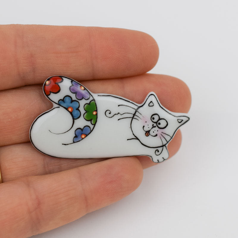 Cat. Porcelain brooch created and hand-painted by Vali Bondoc with high temperature ceramic dyes and colloidal gold.