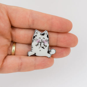Topy cat. Porcelain brooch created and hand-painted by Vali Bondoc with high temperature ceramic dyes and colloidal gold.