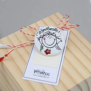 Porcelain brooch created and hand-painted by Vali Bondoc with high temperature ceramic dyes