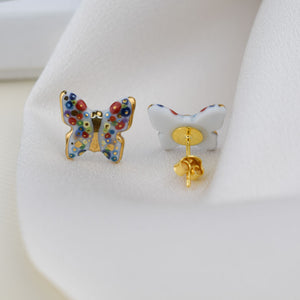 Butterfly. Porcelain stud earrings created and hand-painted by Vali Bondoc with high temperature ceramic dyes and colloidal gold