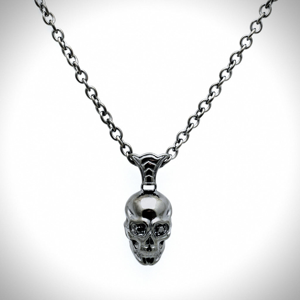 Skulls Head Pendant with Black Sapphires