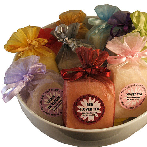 bowl of assorted handmade soap in assorted color organza bags
