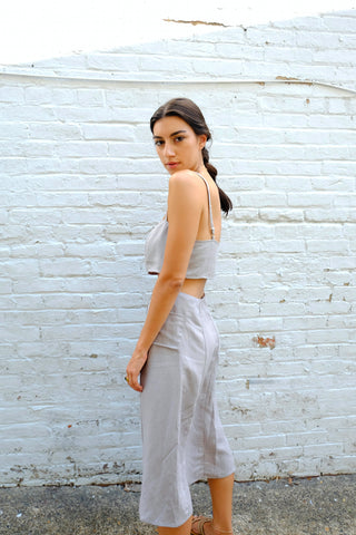 Fashion image of a model in grey co-ord set
