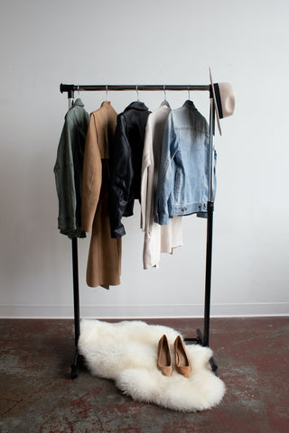 clothes & a hat on a hanging rail