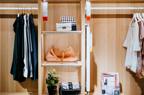 Chuttersnap image of clothes hanging on rails