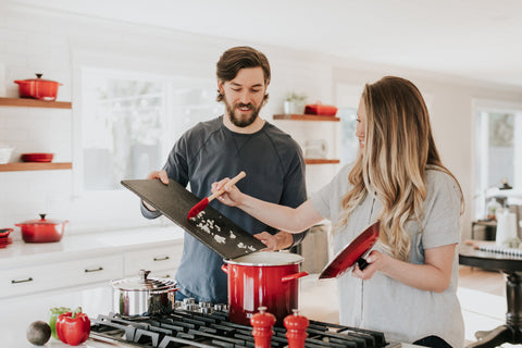 Couple cooking together, Unsplash image.