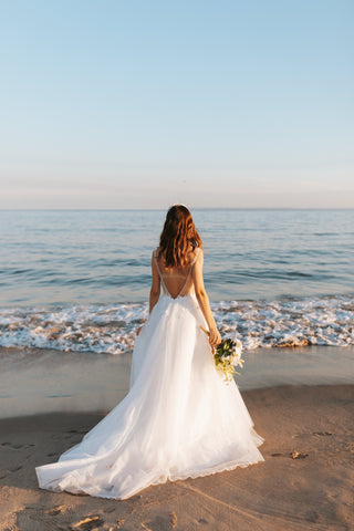 Bride on the beach by Brittney Weng on Unsplash