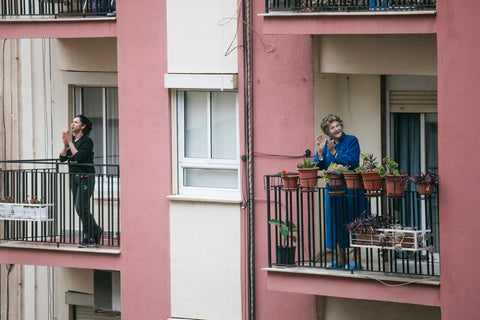 Unsplash image of neighbours on adjoining balconies