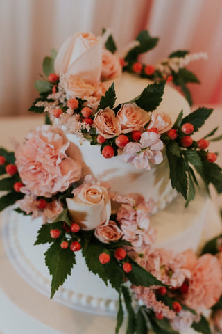White cake decorated with floral garlands