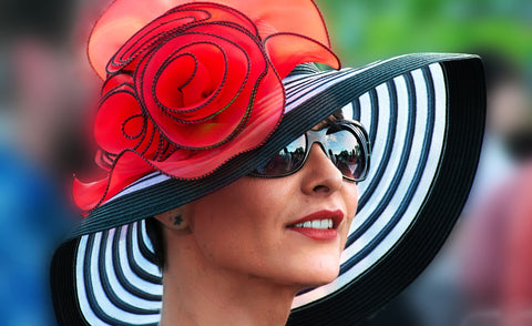 pixabay image of a woman in a black, white, and red hat