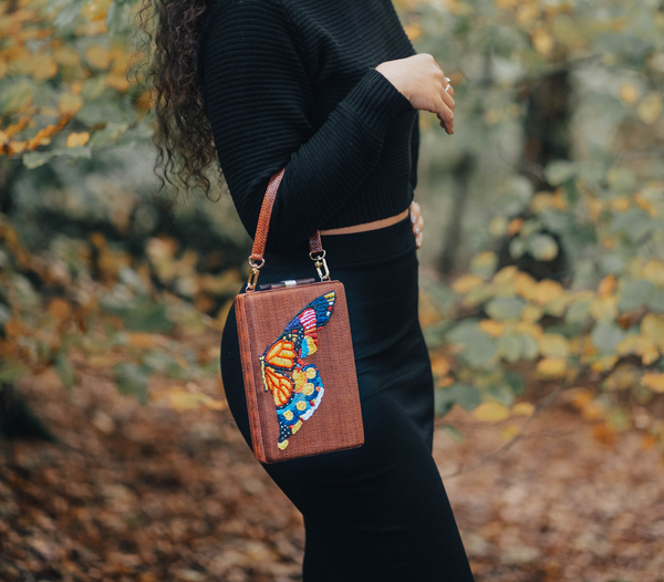 GUSTOKO Chouko clutch handwoven & embroidered bag on model's arm