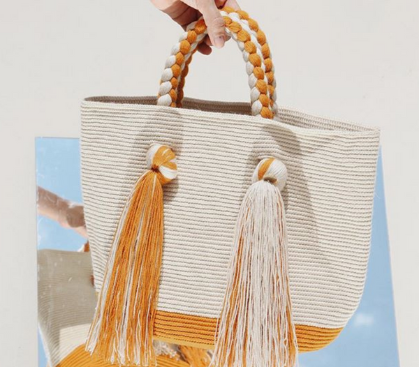 Juanma handwoven tassel tote bag stone/orange, in front of mirror