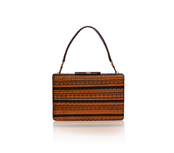 Handwoven GUSTOKO Mojave clutch in orange and black